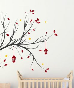 tree branch with hanging lanterns